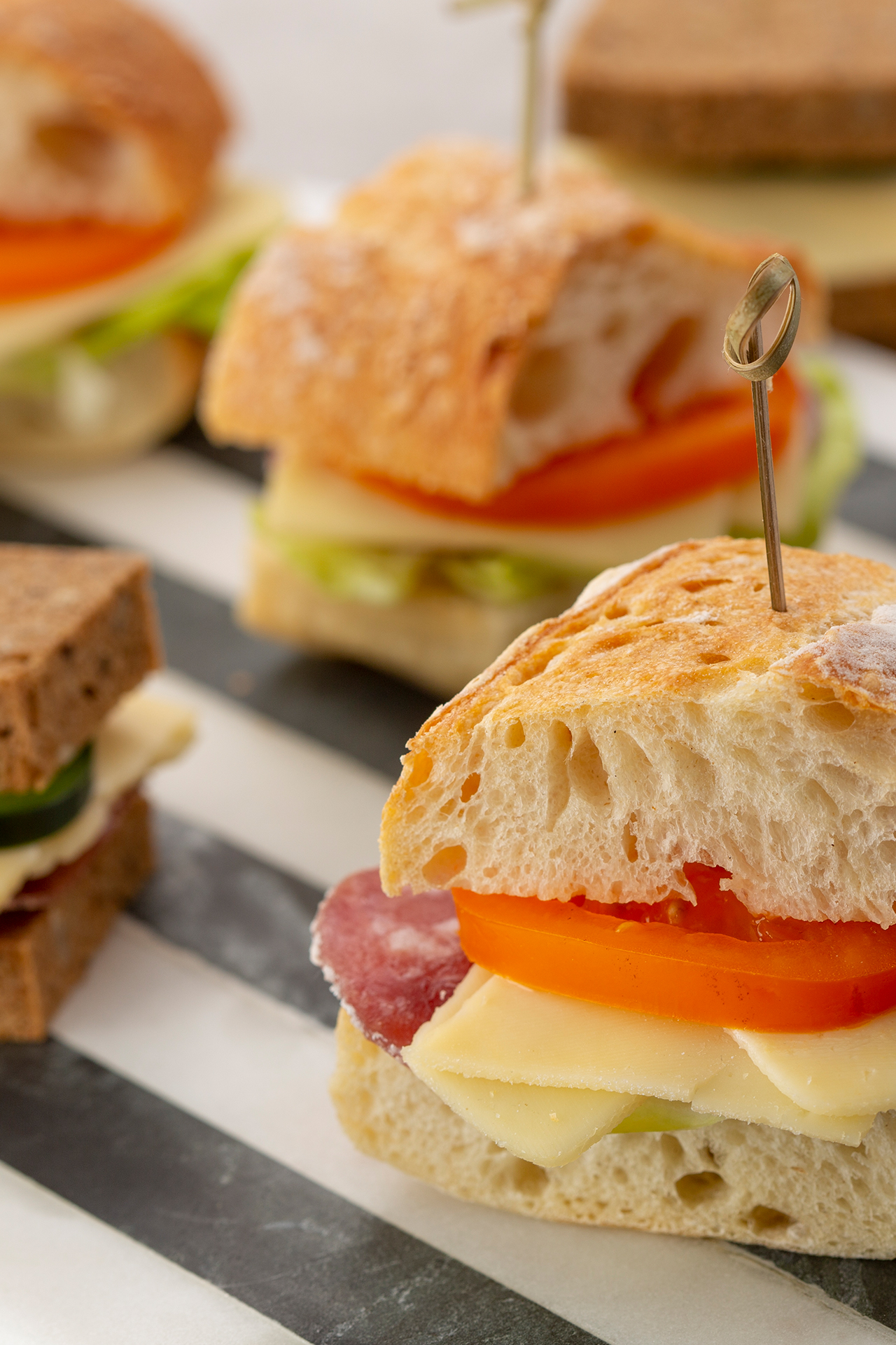 Mini sandwiches with Brie slices