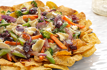 French style nachos with Brie au Bleu and cranberries