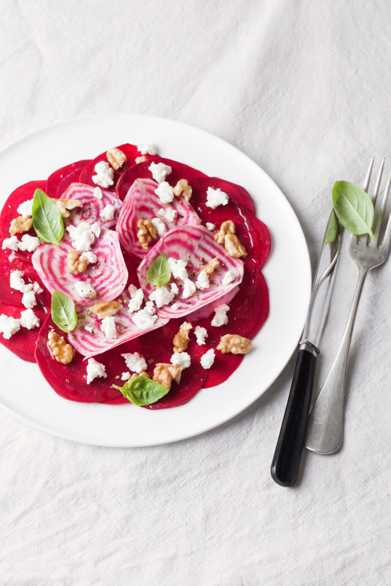 Raw beetroots carpaccio with goat cheese and walnuts