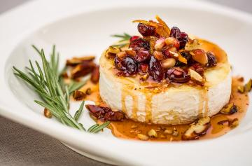 Baked Petit Brie with cranberries and pomegranate